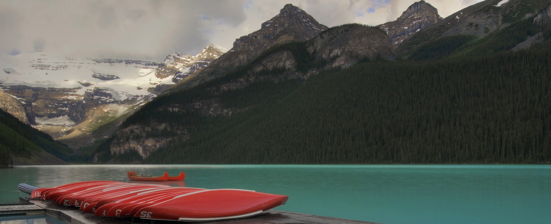 Red Canoes on Lake representing simplicity of Hacknowledge's cyber security solutions